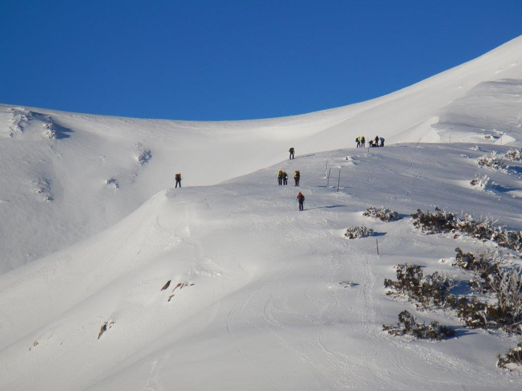 Searchers assembling above the avalanche site